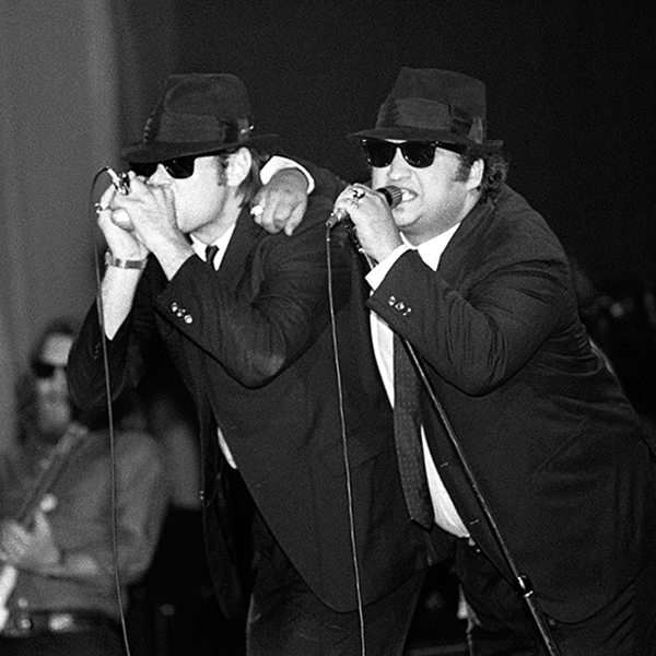 Dan Aykroyd and John Belushi with Steve Cropper in back performing with The Blues Brothers in 1980.